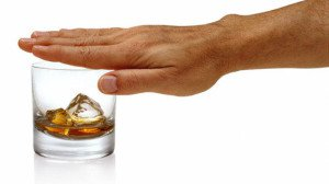 Man Covering Whiskey Glass With Hand